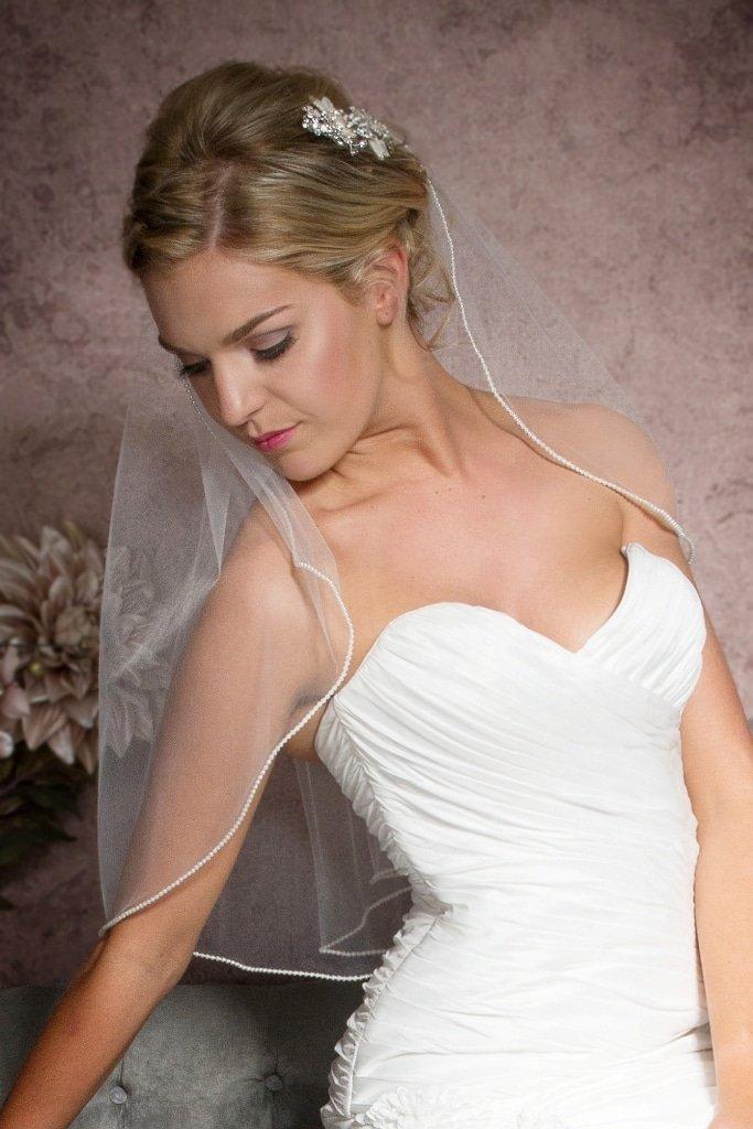 Elbow length veil with pearl edge closeup