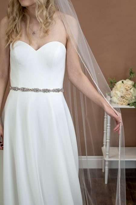 Alexandra - one layer chapel veil with rhinestone edge and diamantes falling stars on bride front closeup