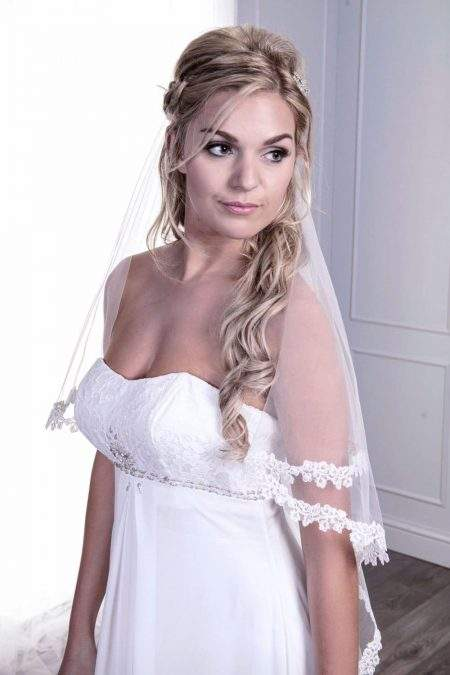 Close up of bride in wedding bridal veil with narrow lace edge