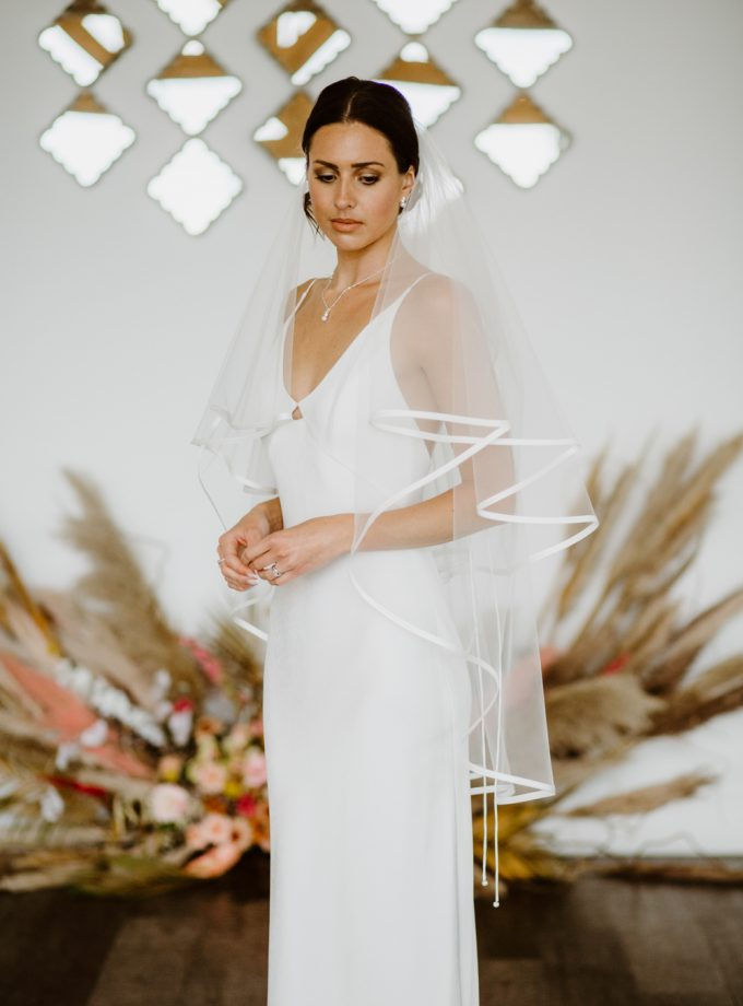 Brittany - two tier fingertip length veil with satin edging
