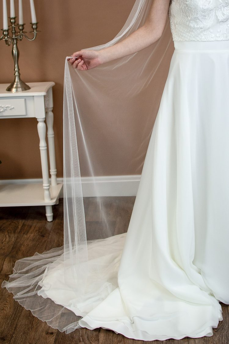 Brooklyn - slim and narrow single layer chapel length veil in silk effect tulle front closeup