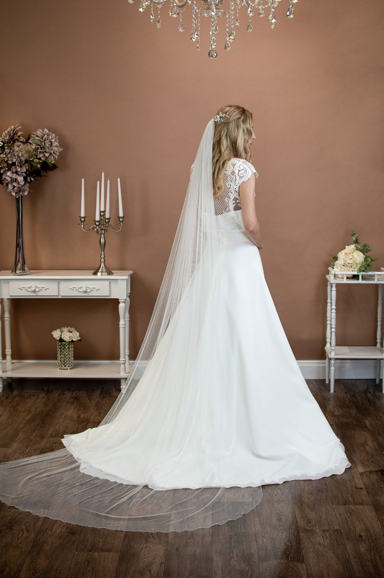 Brooklyn - slim and narrow long single layer chapel length veil in silk effect tulle on a bride