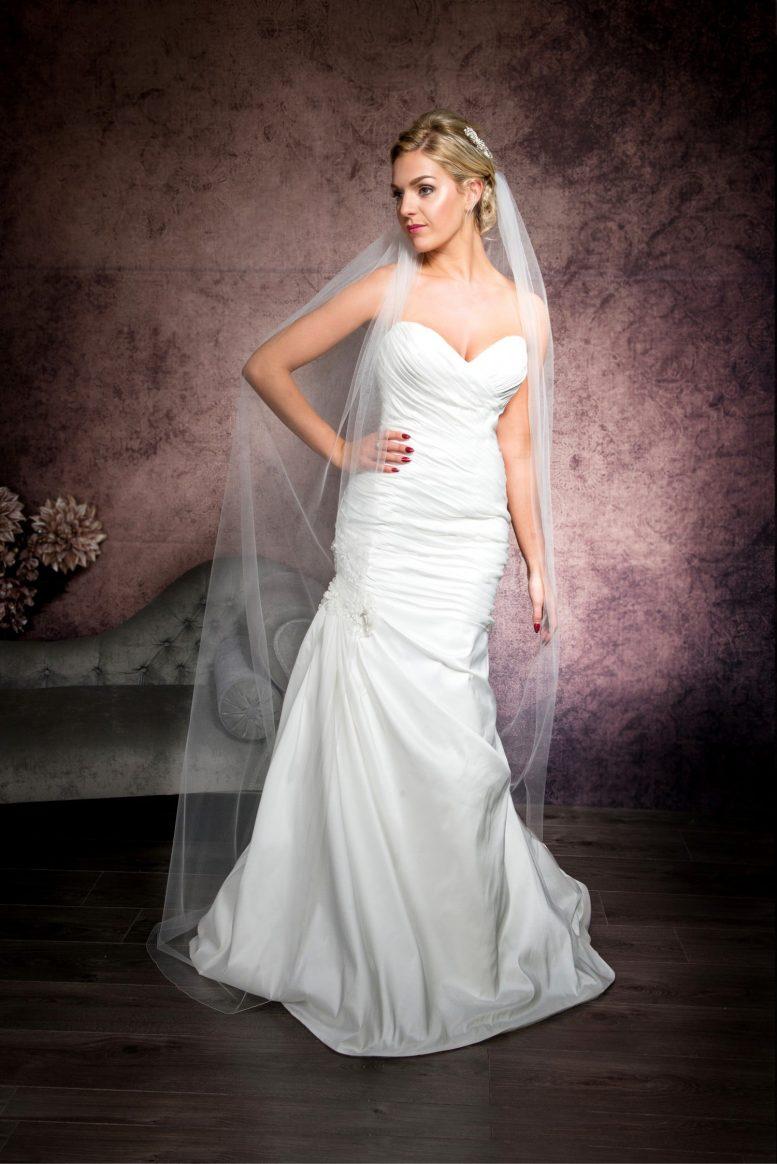 Statuesque bride wearing a floor length veil