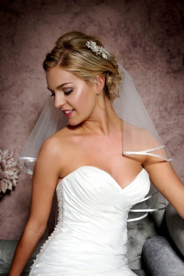 Elbow length ribbon edge veil