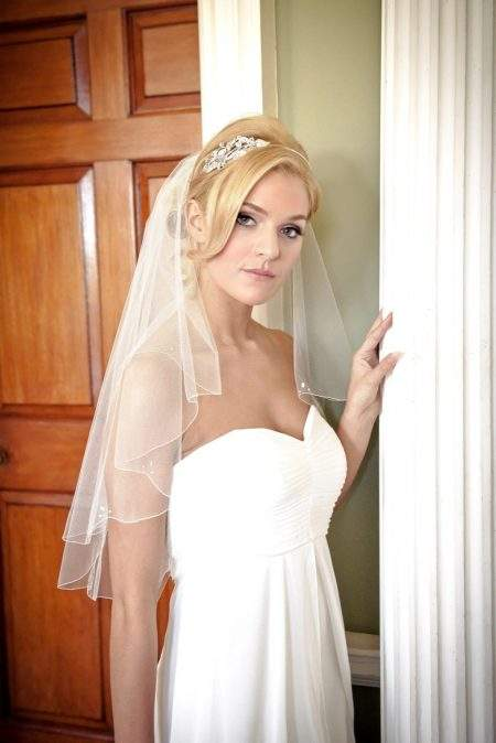 Pretty bride at Lytham Hall wearing waist length veil
