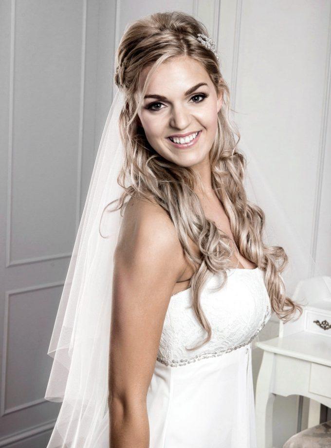 Bride wearing veil with half up half down hair