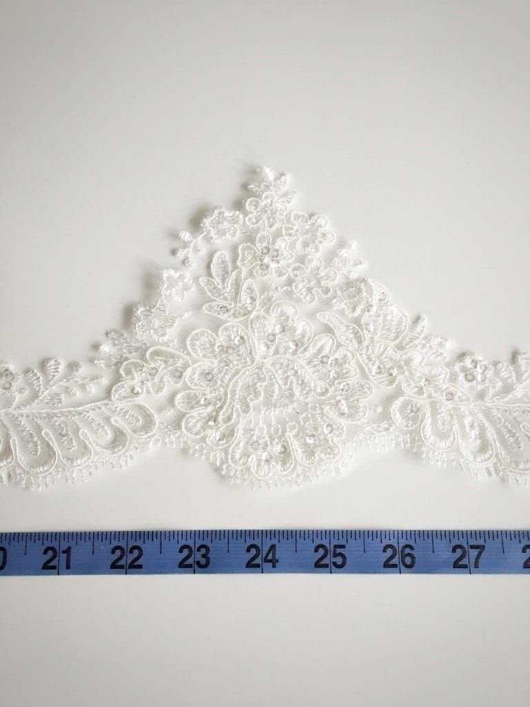 Scalloped sequinned lace