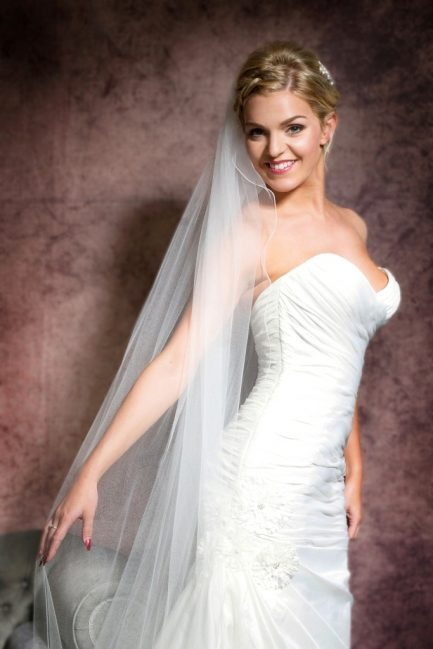 Bride wearing a long flowing cathedral length veil