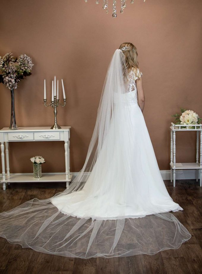 Isabella - one layer long cathedral length extra wide veil with a wavy edge on a bride