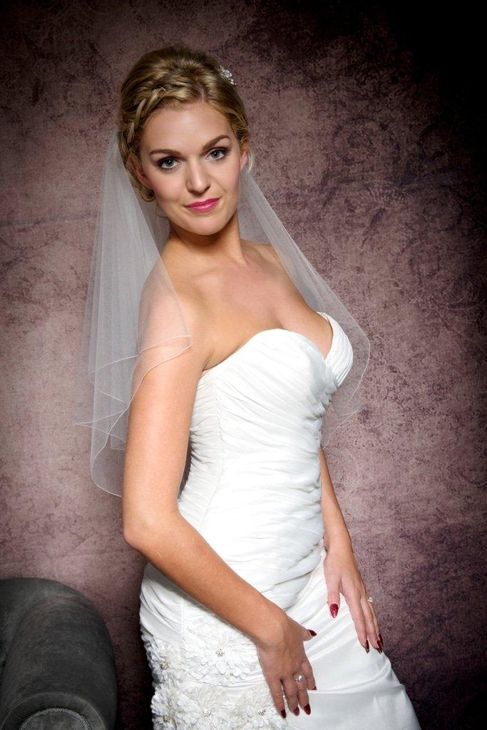 Portrait of bride wearing a waist length veil
