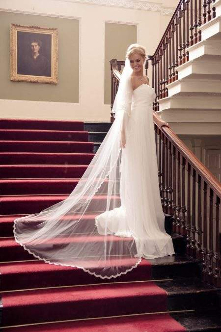 Lacey – two layer chapel length veil with a narrow lace edge