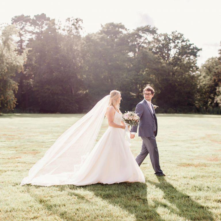 Chapel length lace edge veil on bride