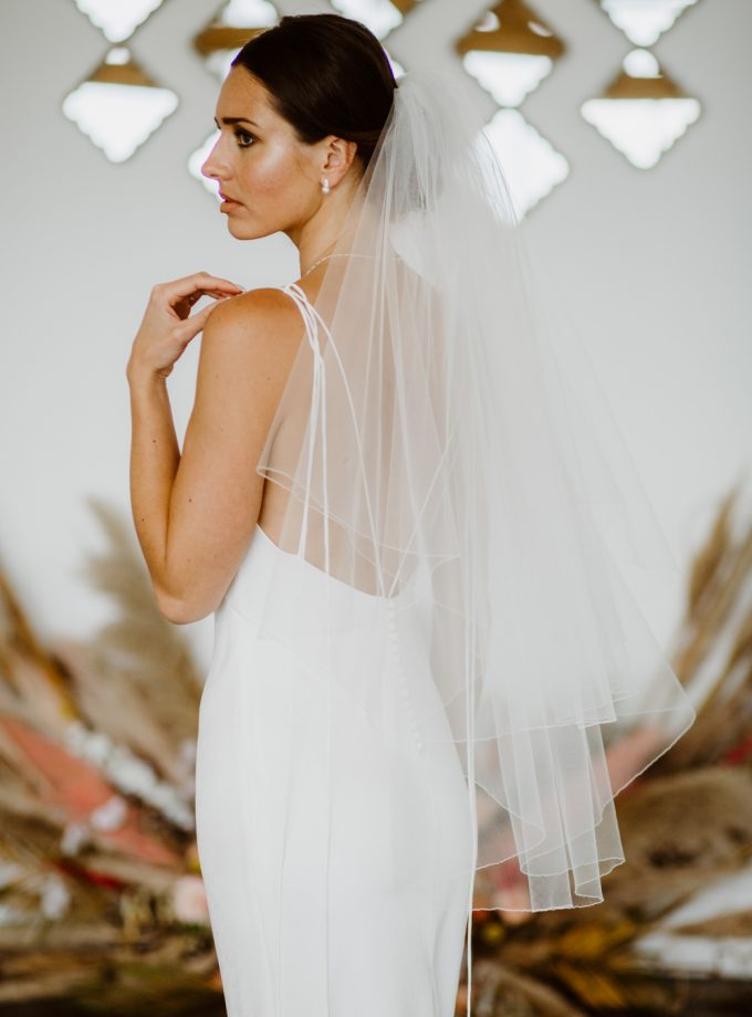 Megan- two layer hip length veil with a pencil edge