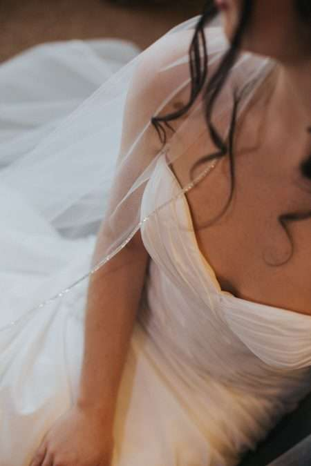 Natalia – one layer chapel length veil with a rhinestone trim closeup