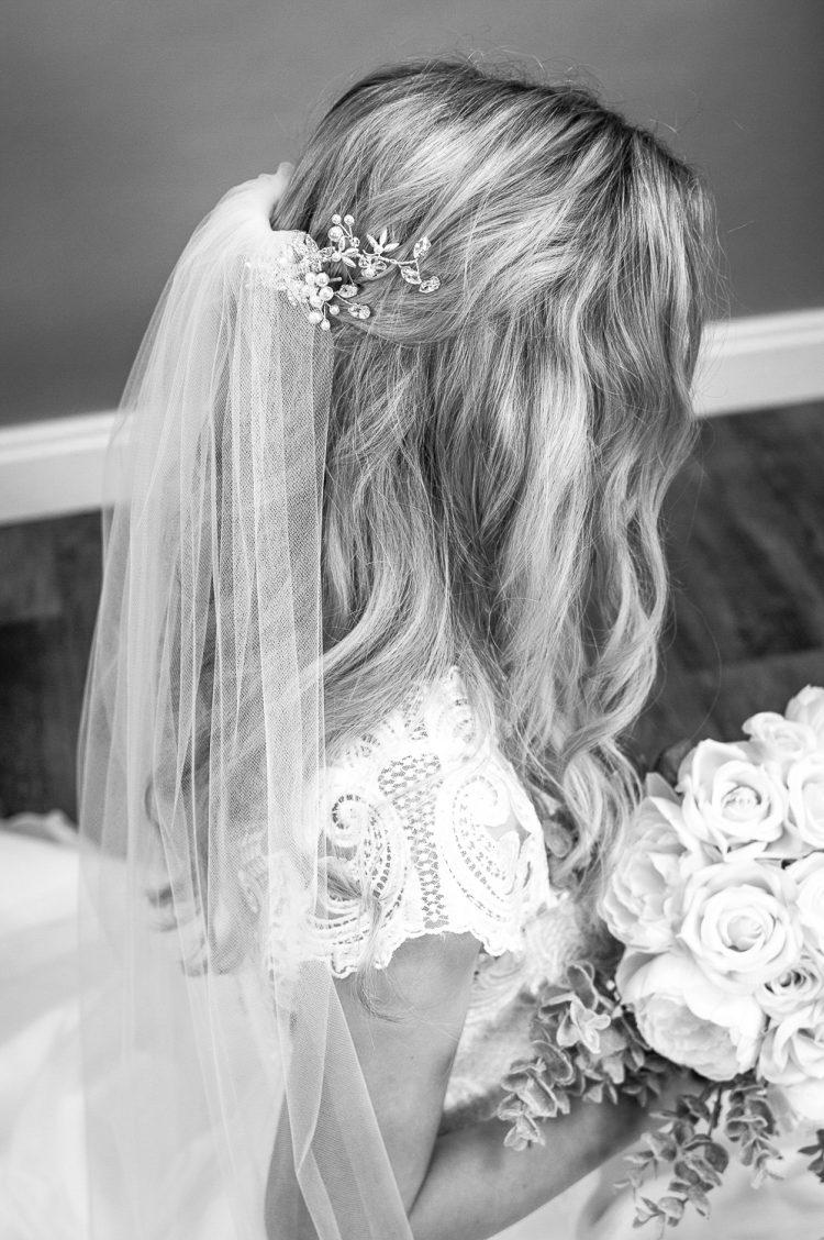 Skye - beautifully plain hand cut single layer chapel length wedding veil closeup bw