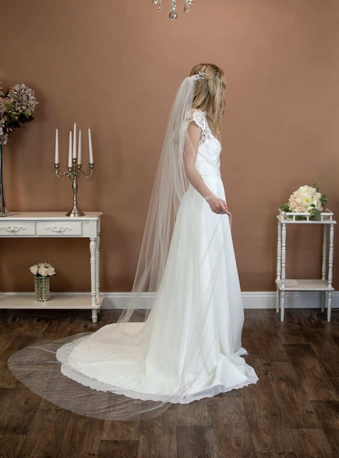 Skye - beautifully plain long hand cut single layer long chapel length wedding veil on a bride