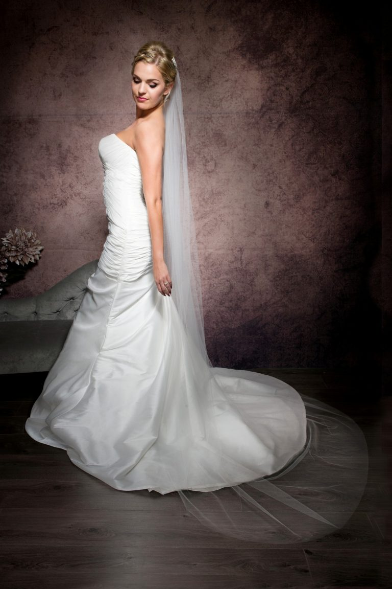 Bride wearing a simple and plain chapel length veil