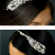 TLT4578 – pearl & diamante side headband with a scrolling design