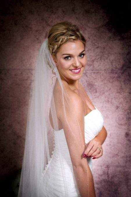 Close up of a bride wearing single layer cathedral length veil