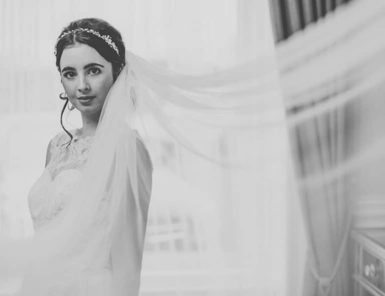 Bride in plain chapel length veil with a pencil edge