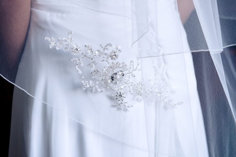 Close up of a wedding veil with lace appliques