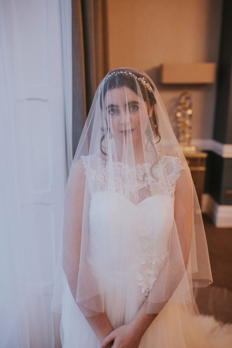 Bride wearing veil over the face - pretty drop veil with pearls