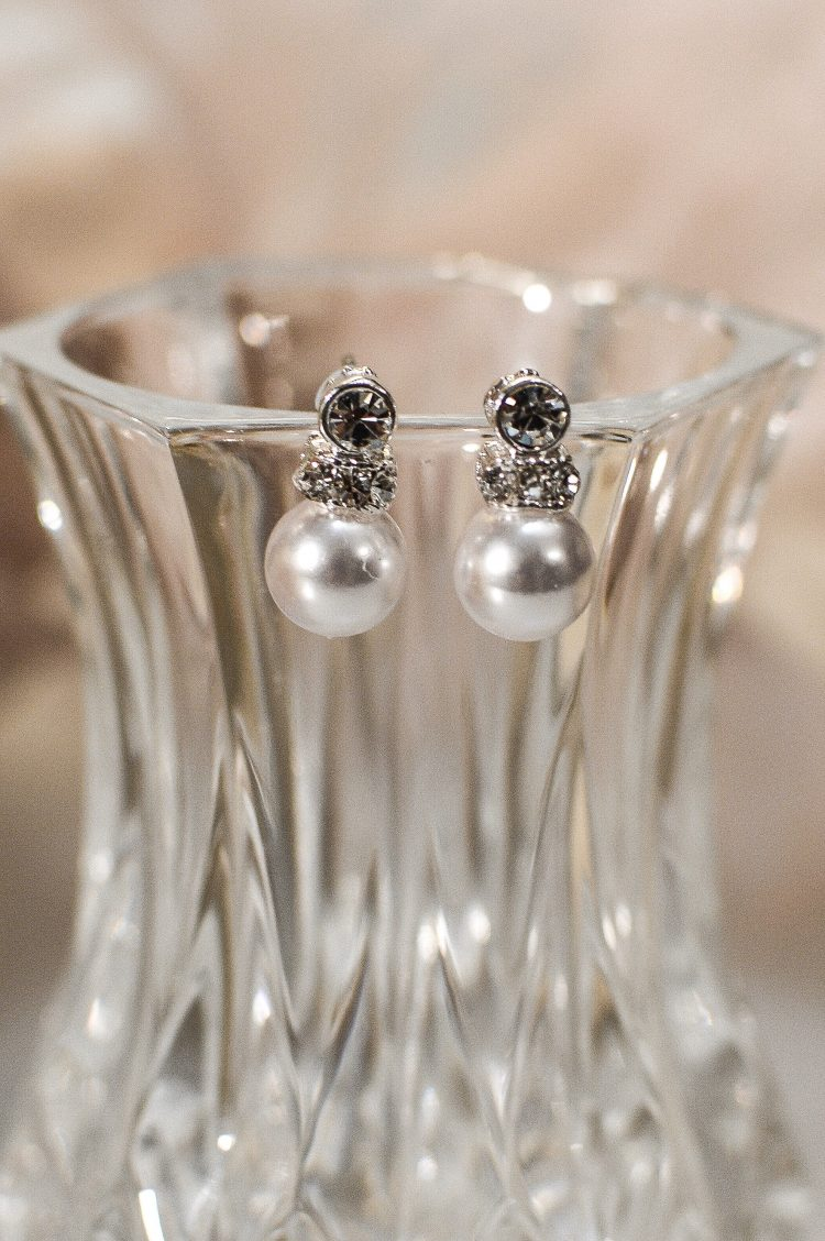 tls1536 earrings on glass closeup