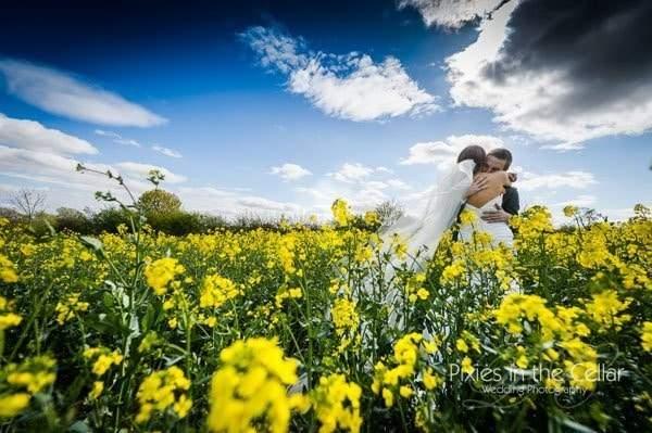 Bespoke chapel length veil on Real Bride Katherine in field of flowers