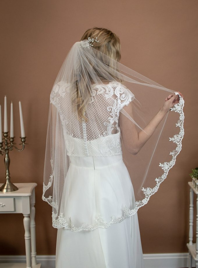 Alana - short single layer hip length veil with silver and ivory lace topped with a hand beaded edge on a bride