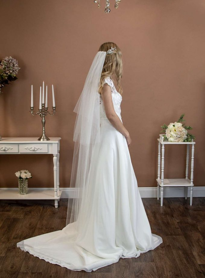 Angelina - long two layer plain wedding veil with a hand cut edge in waltz length on a bride