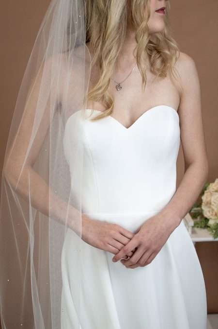 Bianca - single layer chapel length veil with diamantes on bride closeup front