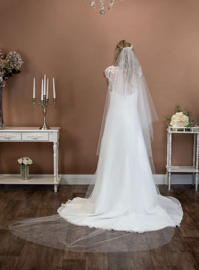 Caitlyn - long two layer chapel length plain veil with a cut edge and extra long blusher on a bride