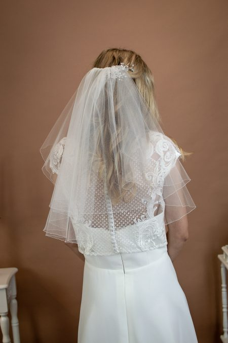Charlie - two layer shoulder length veil with a pencil edge on a bride back view