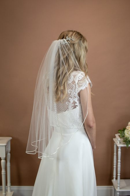 DAISY – one layer waist length veil with a pretty narrow ribbon trim