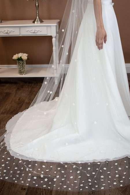 Fleur - single layer chapel length veil with 3D fabric flowers closeup bottom