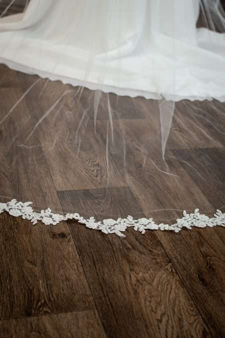 Hope - one tier chapel length veil with wavy lace appliques bottom of train