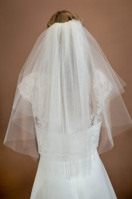 Priscilla - 1960s inspired short bouffant wedding veil with a cut edge back closeup
