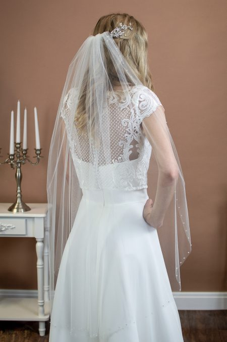 STELLA – single tier fingertip length veil with a cut edge and a single row of crystals