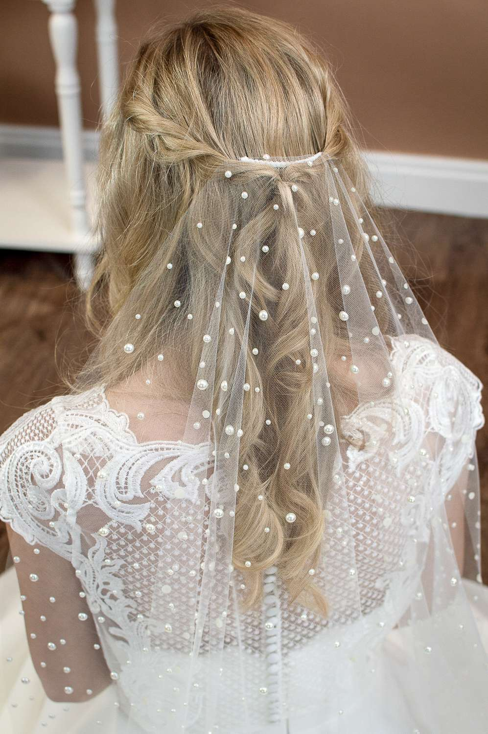 Violet - Single layer barely there veil in fingertip length with a cut edge and mixed size pearls closeup