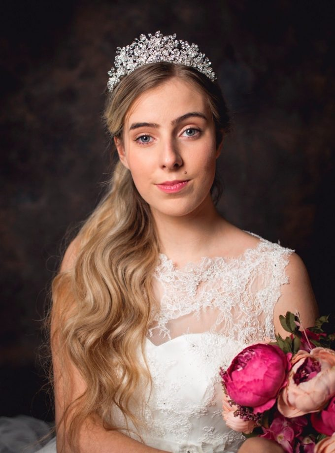Elsa - tall regal tiara with clusters of crystals on model bride