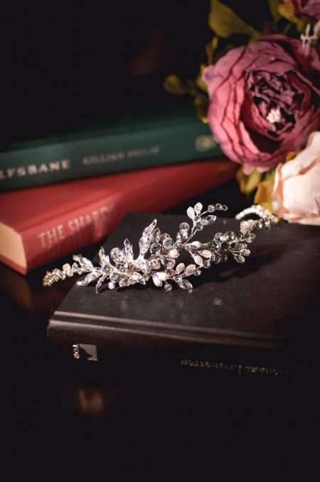 Venus - boho style diamante leaf side headband on books TLT4681