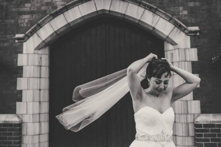 Bride Beatriz wears a short hip length custom veil