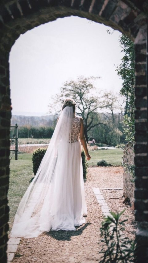 Gorgeous real bride Lucy wearing our bestselling chapel length Brooke veil
