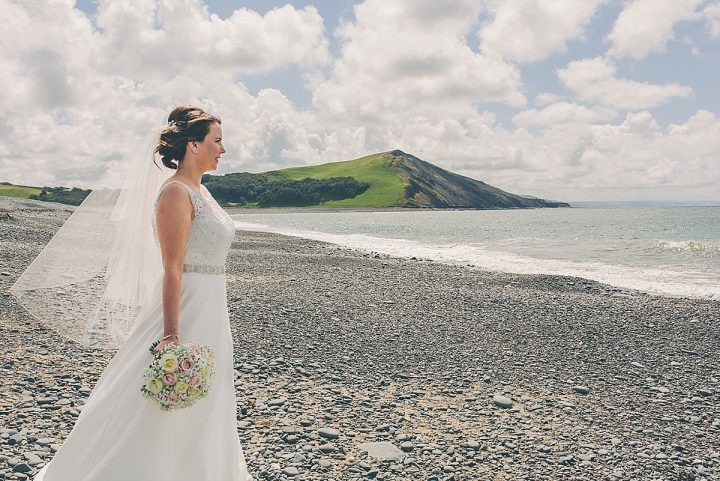 Clare wears our hip length Carrie veil in beautiful Wales