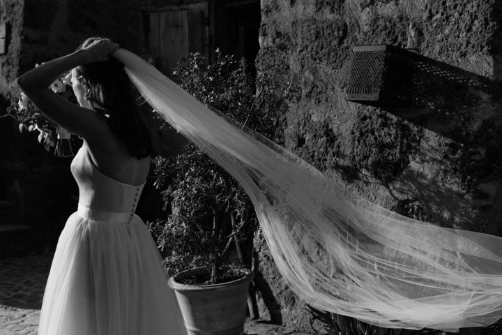 Real bride Emma wears our very popular single layer chapel length veil 'Brooke'.