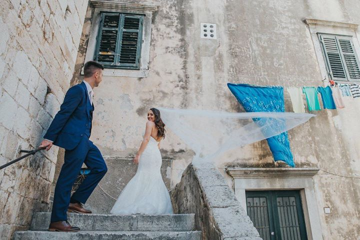 Holly wears our chapel length Brooke veil in stunning Croatia
