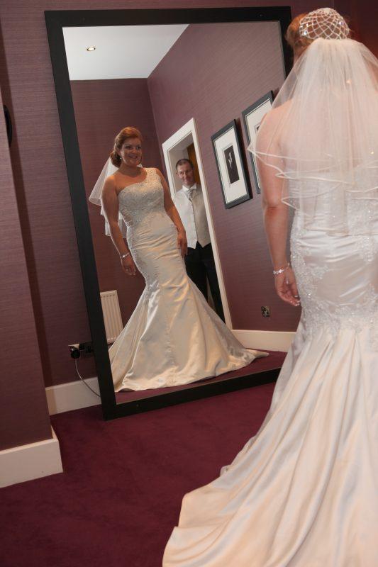 Real bride Leigh-Ann looks amazing her elbow length veil and fabulous beaded skull cap!