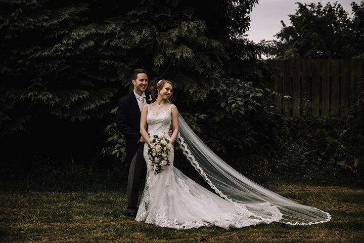Stunning bride Natalie wears our gorgeous chapel length Paris veil