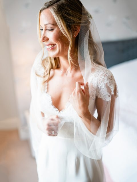 Real bride Olivia wears our barely-there chapel length veil Sia