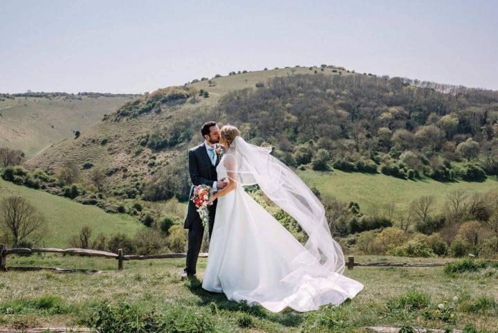 Real bride Jen wears a custom made satin ribbon edge veil in chapel length